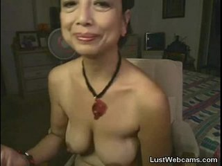 Asian granny masturbates on web cam