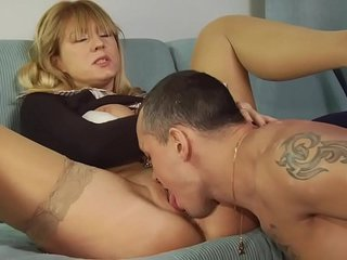 Mature Ann rides on her young lovers dick