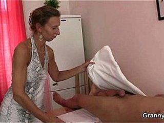 Granny massagist leaps on his cock