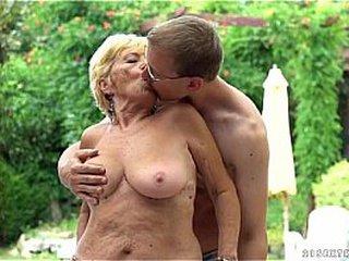 Youthful nerdy dude pounding ash-blonde granny at pool
