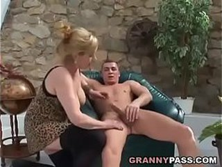 Buxomy granny fucks Young Shaft