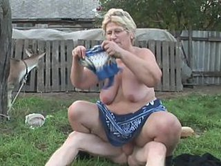 A granny has a craving for young hard-on in her farm and she gives a superb blowjob