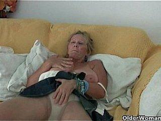 Granny with big tits masturbates in tights