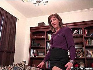 Granny Claire pounds herself with a dildo