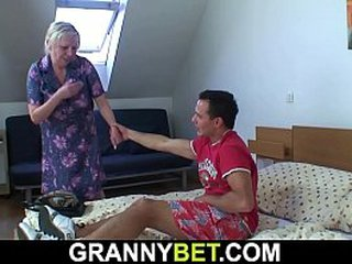 Buxomy granny gets doggy-fucked by nasty young dude