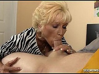 Naughty granny deepthroating and choking on the white cock