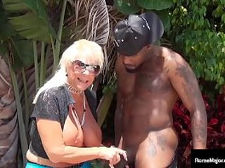 There once was an old lady that guzzled a cock... Granny Mandie McGraw mounts thick black shaft Rome Major in this dock fucking bi-racial young/old clip! Total Flick & More Women @ RomeMajor.com!