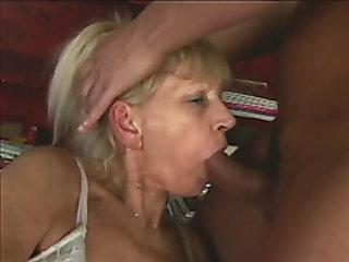 Blonde granny sucks and fucks a young shaft