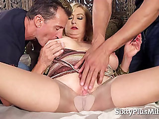 Blonde GILF in an interracial 3 way