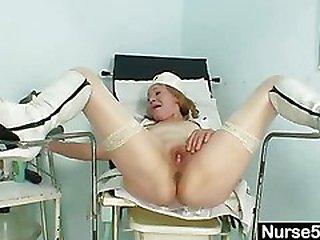 Kinky grandma wears pump boots and toys herself