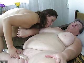 Old plump mom teaches her plump younger woman jerking use fake penis
