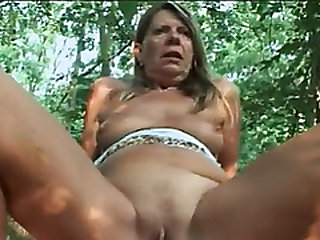 Blonde gilf Samantha rides long dick in forest