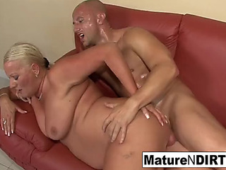 Breasty blonde grandma takes it in the butt