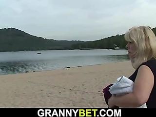 Blond granny rides stranger's penis on public
