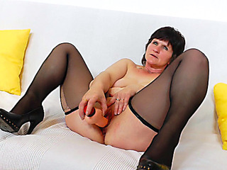 Granny stretches her holes with a massager